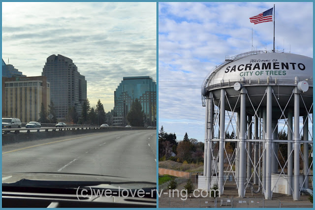 Quiet freeway passing through city and water tower at south end.