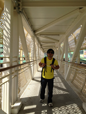 Walking at the over pass going to the bus Stop to Yas Island