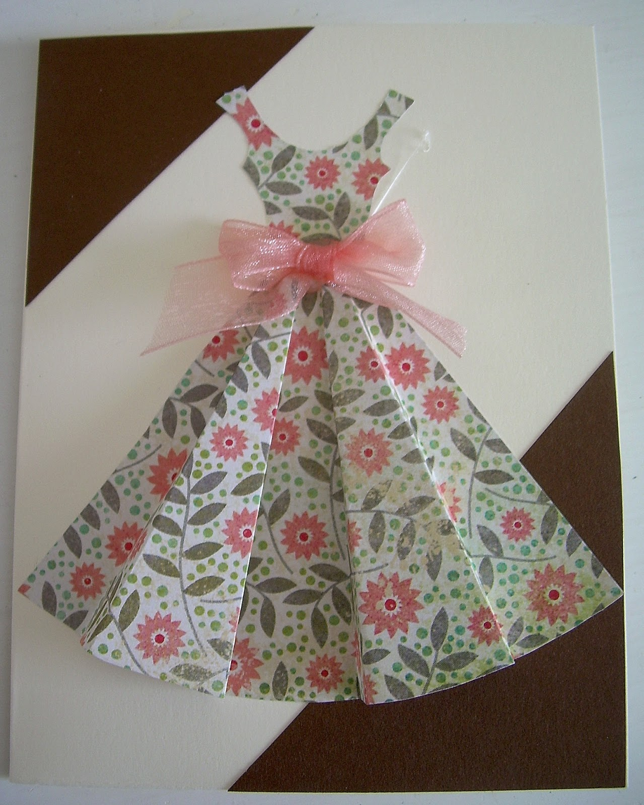 If you are interested in the pattern to make a dress card of your own ...