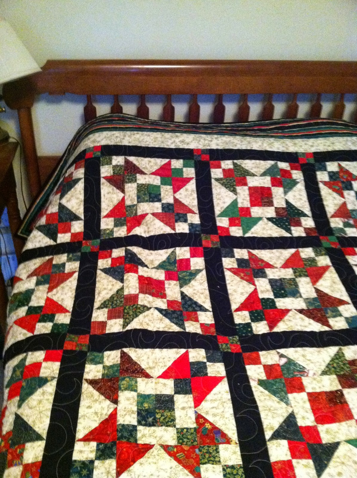 "Scrappy Christmas Quilt - I love the ""controlled scrappiness"" of this quilt."