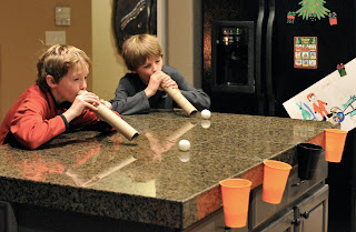 two kids playing snowball games