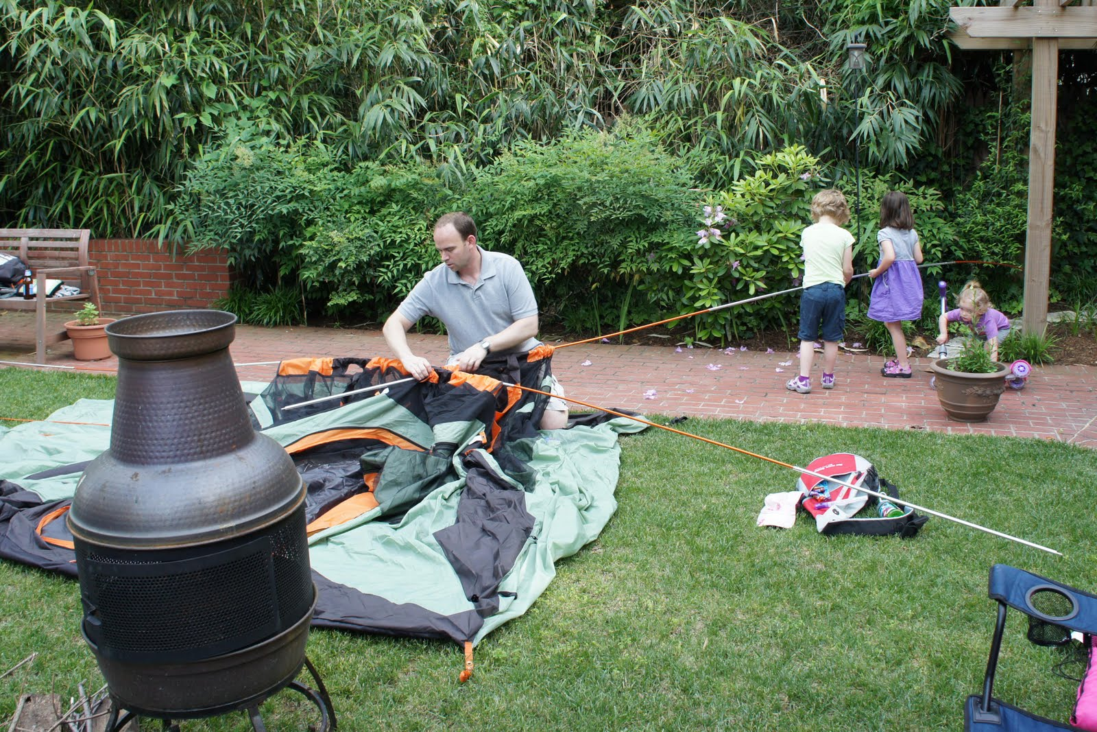 backyard camping! How many kids does it take to help Daddy assemble