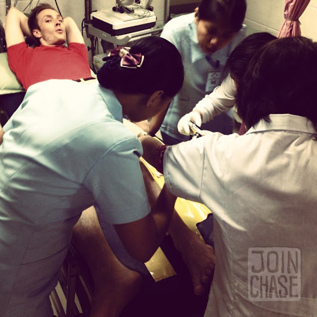 Chase Chisholm surrounded by nurses in an emergency room of a hospital in Yangon, Myanmar.