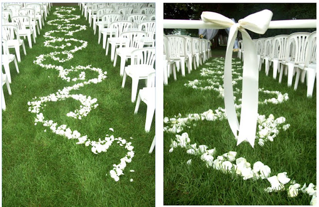 sweet pea floral design ann arbor michigan wedding A rose petal aisle with a fancy swirl pattern was roped off and ready for the big walk