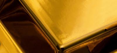 Złote sztabki i monety bulionowe