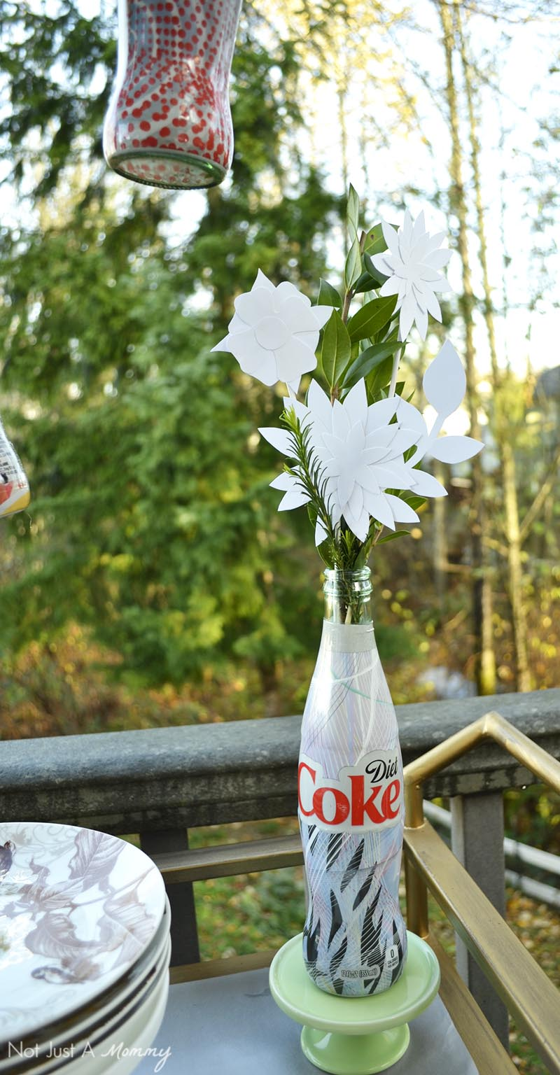 Handcut paper flyers in a upcycled Diet Coke vase