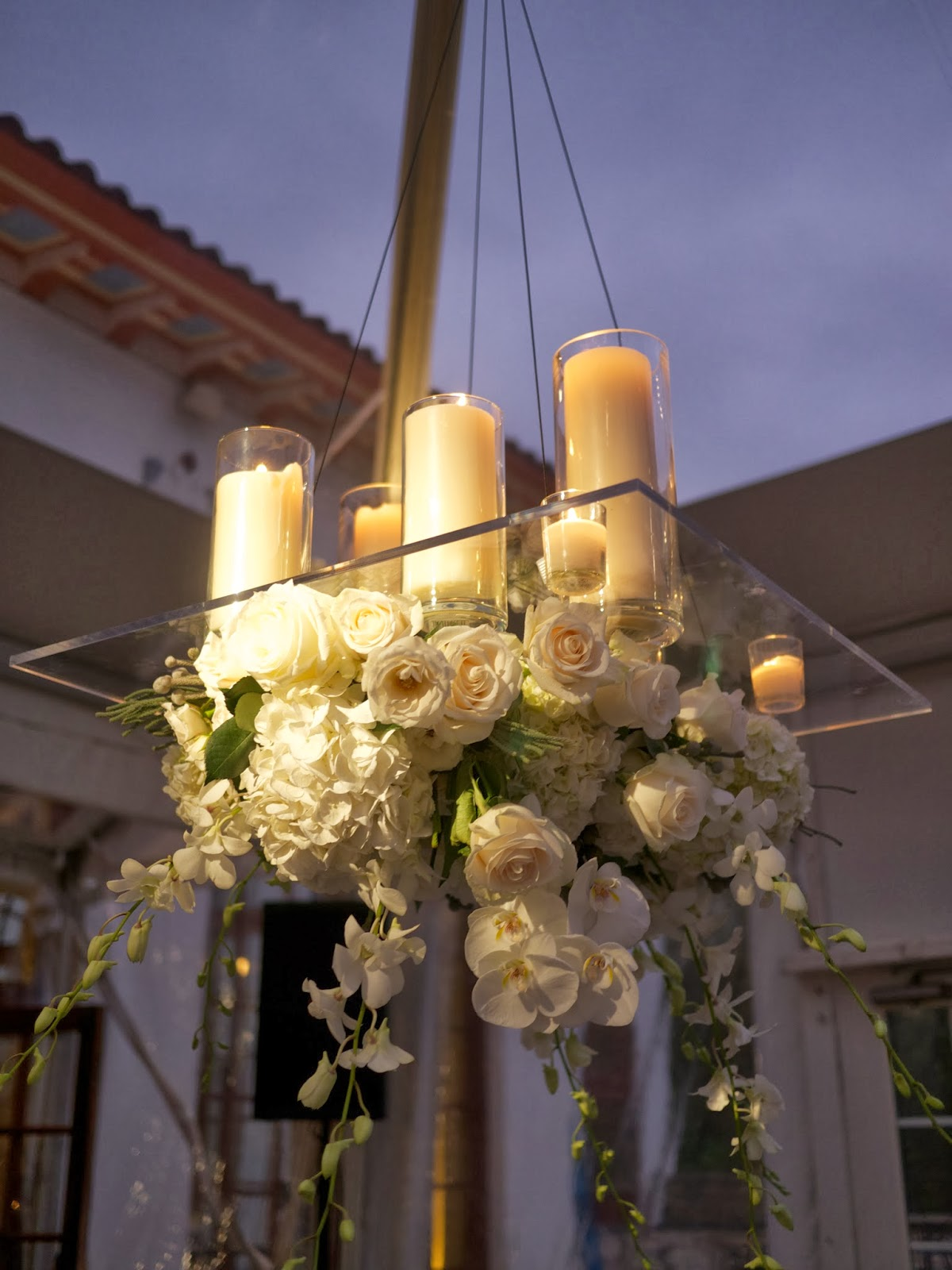 Petals and ponderings sleek simplicity with fire water and air individual plexiglas chandelier with florals suspended below aloadofball Image collections
