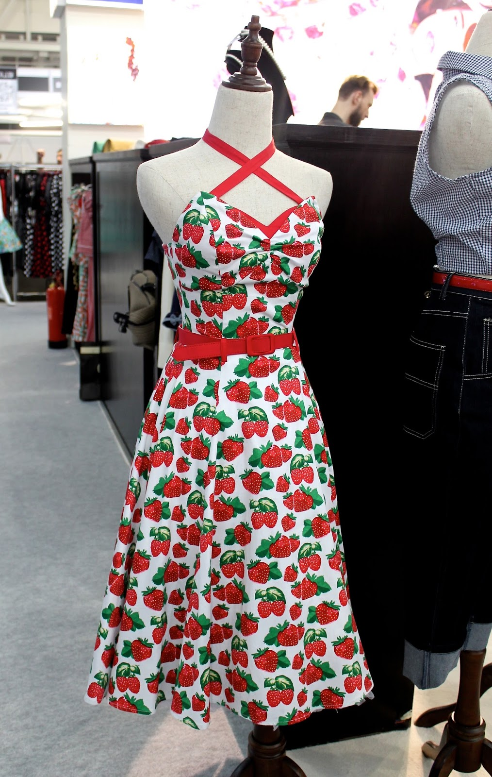 Collectif strawberry print dress with winged bust