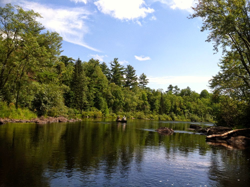 Canoeing on Wisconsin's wonderful smallmouth bass rivers, with a fly rod in hand.