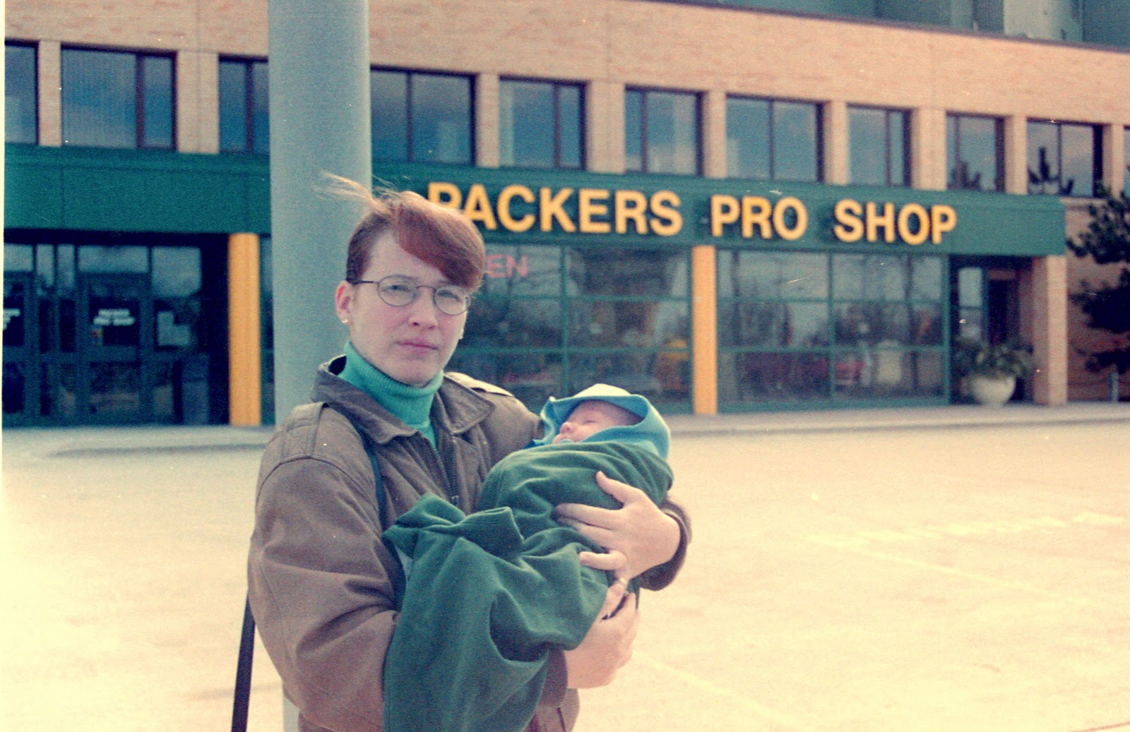 Outside lambeau with our 1st born it was cold