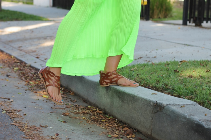 Green pleated maxi skirt with tan gladiator sandals