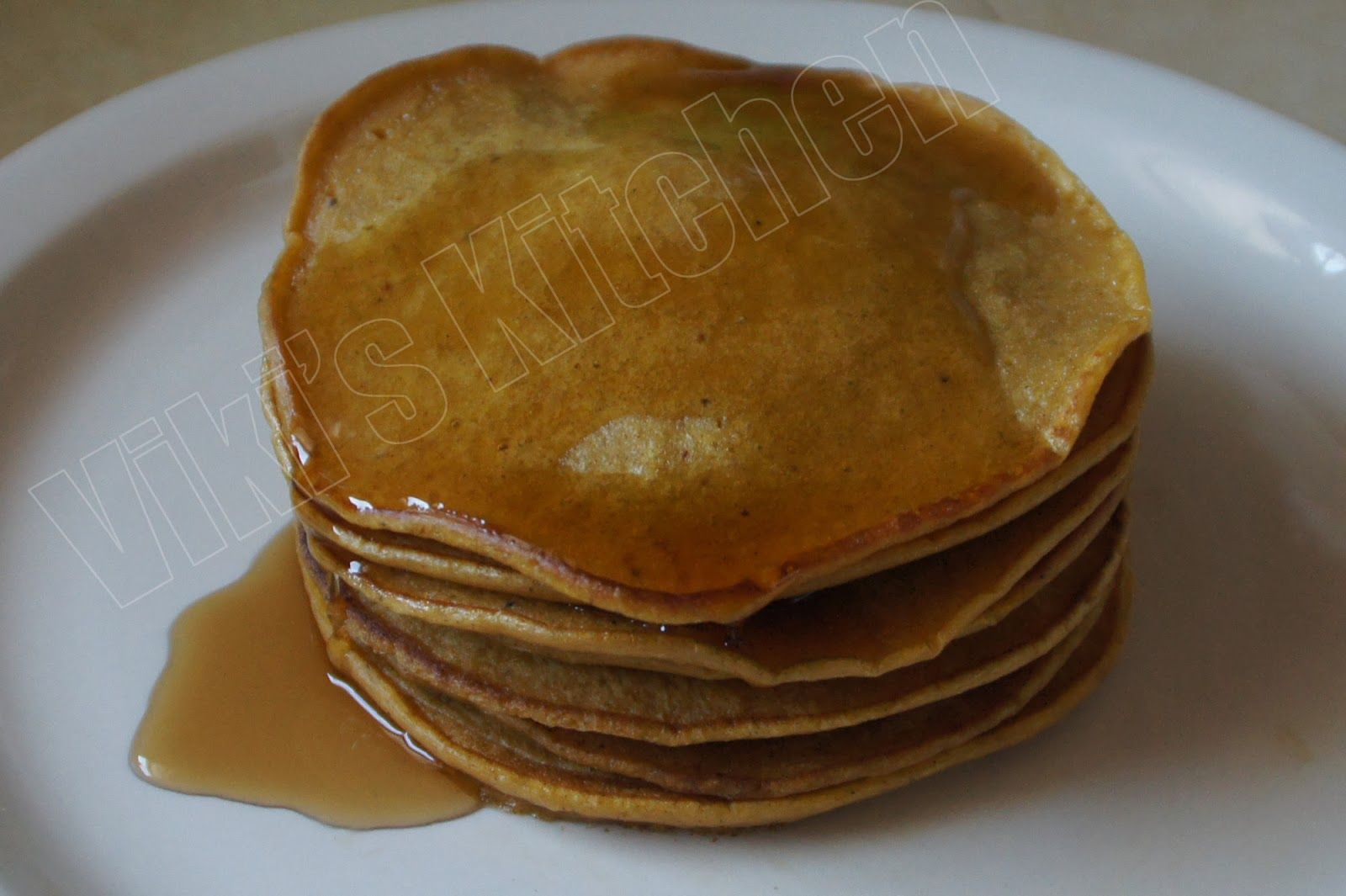 Pumpkin pancakes with maple syrup.