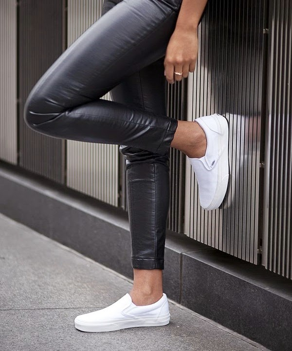 leather pants and white slip on vans