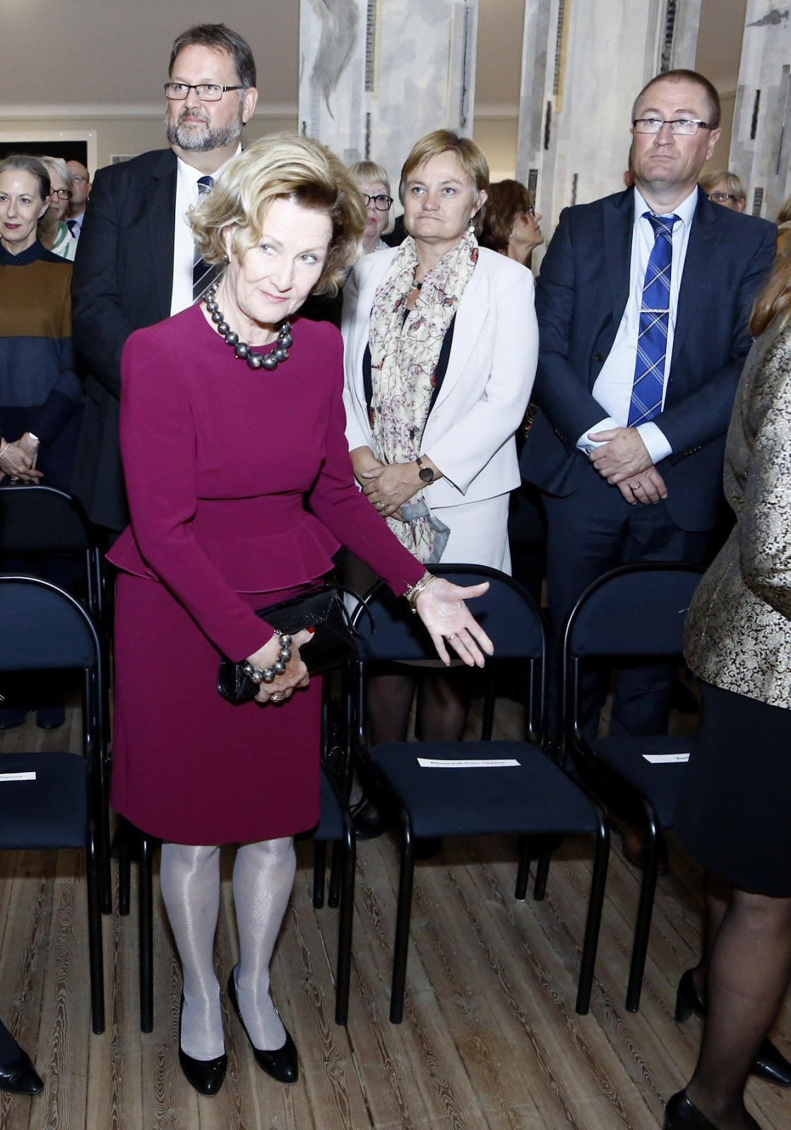 Queen Sonja wore a very elegant burgundy peplum styled dress.