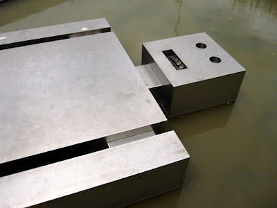 Ronnie van Hout's 'Fallen robot' sculpture of a metal robot in a pond.