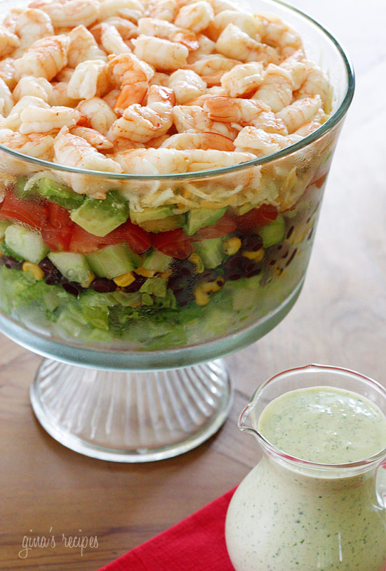beautifully layered salad with shrimp, avocados, grilled corn, black ...