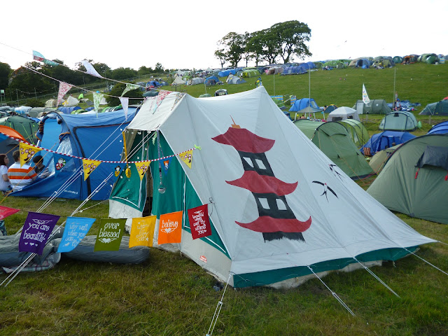 painted cabanon tent at a festival with bunting