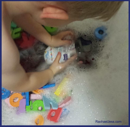 Learning through play with H&A foam letters and tub