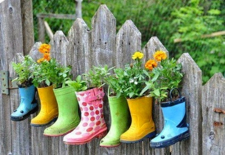 http://www.shelterness.com/35-ideas-to-use-old-shoes-as-planters/