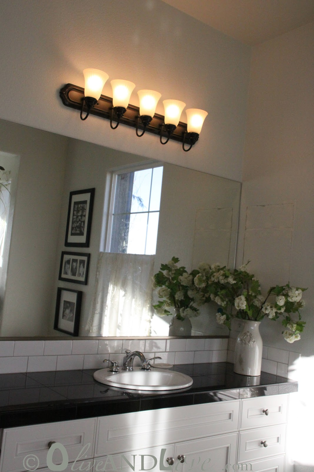 olive and love spray painting bathroom light fixture