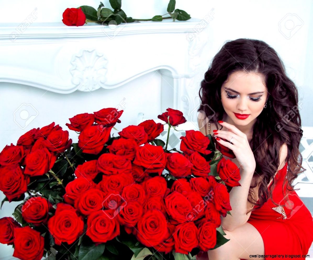 Beautiful Young Woman With Red Roses Flowers Bouquet In Modern