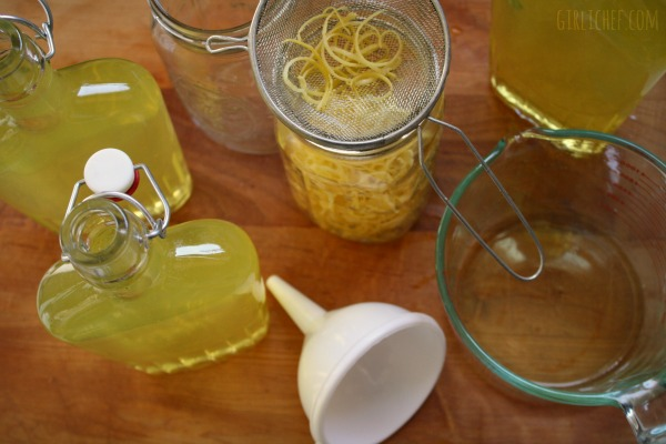 straining Limoncello @ http://www.girlichef.com/2013/03/ArancelloLimoncelloDIY.html