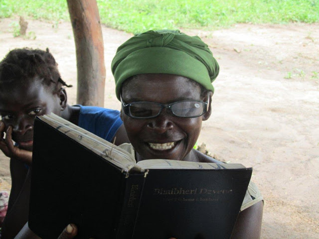 Smiling woman reading