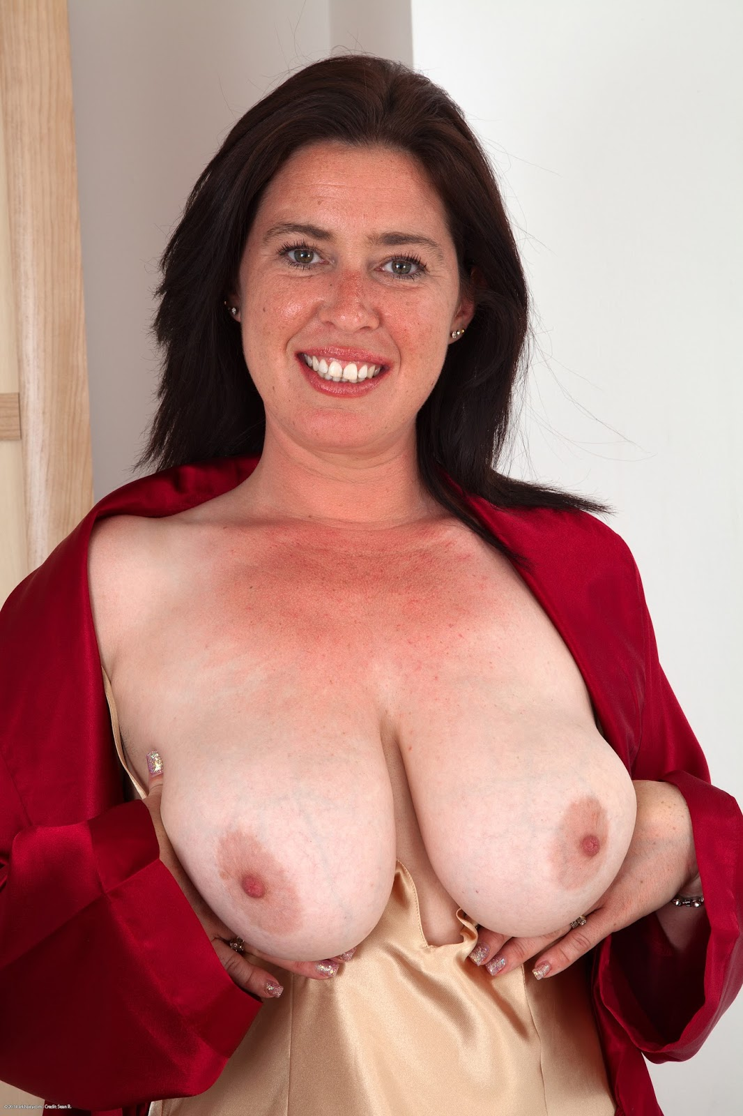 Mature cinna page gets naked in the kitchen 2