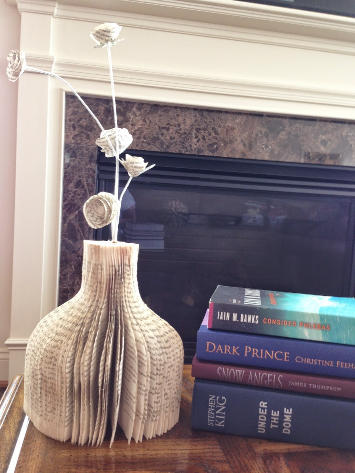 http://plumperfectandme.blogspot.com/2014/07/how-to-cut-book-into-vase.html