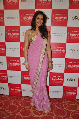 Isha koppikar in a pink saree