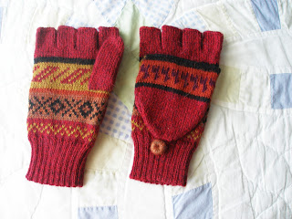 red multicolored knitted fingerless mittens with alpacas on them