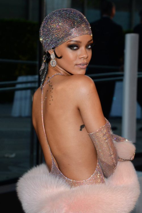 Rihanna style fashion wearing red  carpet adam selman cdfa