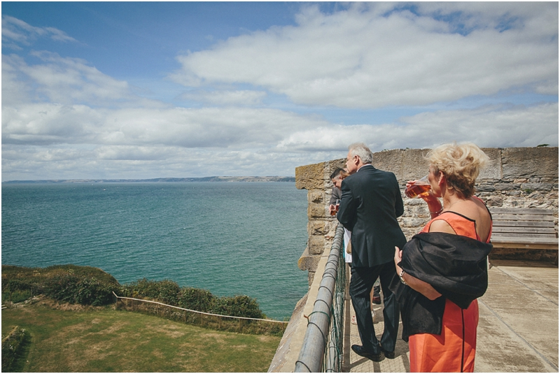Guests looking at sea view