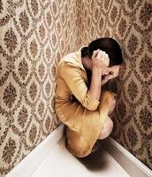 sad woman in a corner