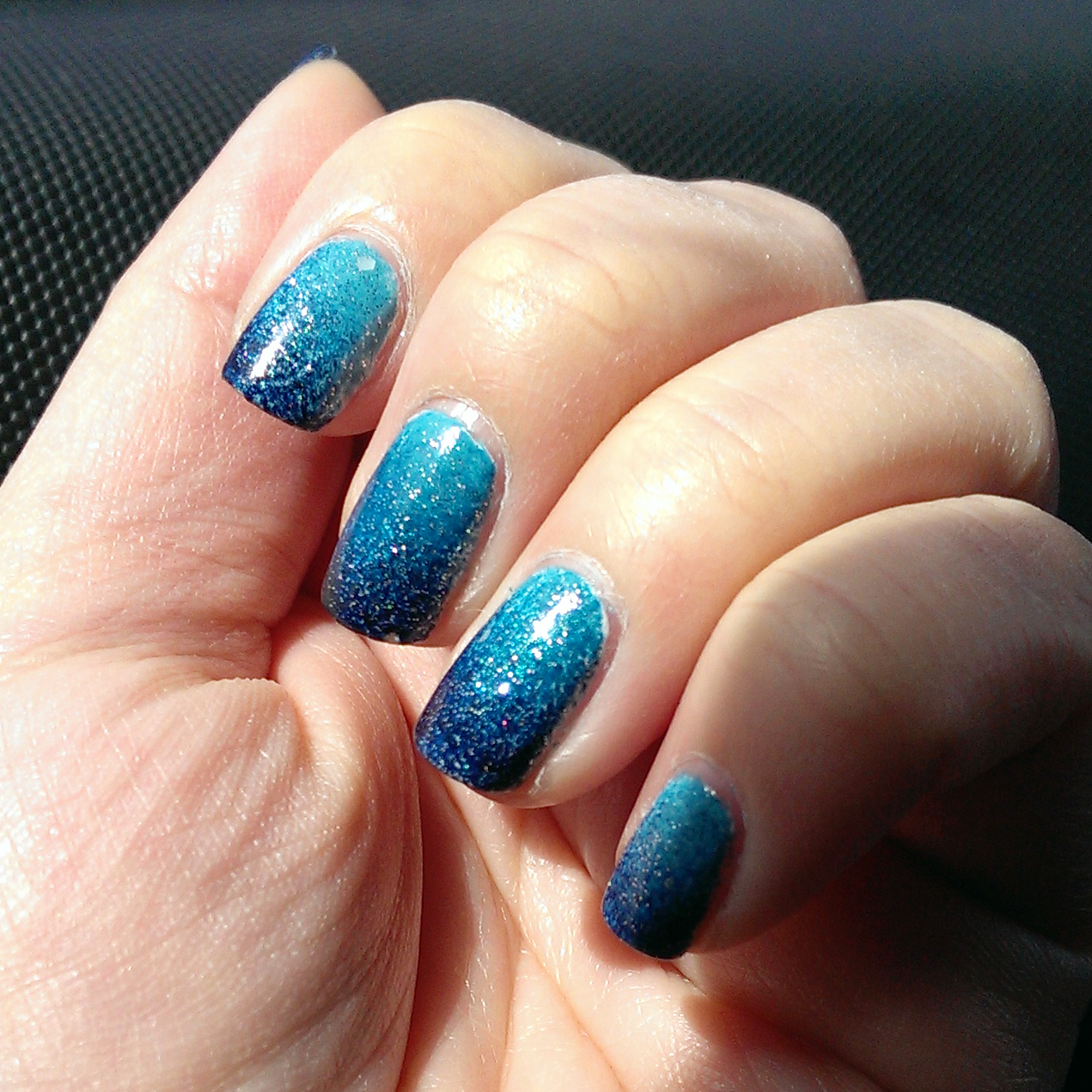 http://www.glitterandglossnails.com/2014/04/blue-ombre-with-glitter.html