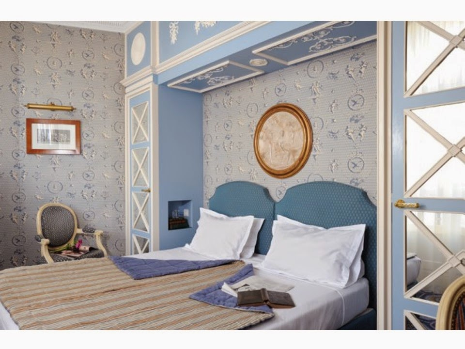 hotel room decorated in shades of beige and blue