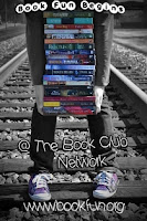 woman standing on railroad tracks with books in her arms