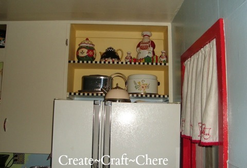 Retro kitchen makeover with antiques and collectibles on display with Mary Engelbreit inpirations