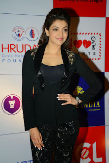 Actress Kajal Agarwal Latest Pictures in Stylish Black Dress at CCL Charity Dinner  14.JPG