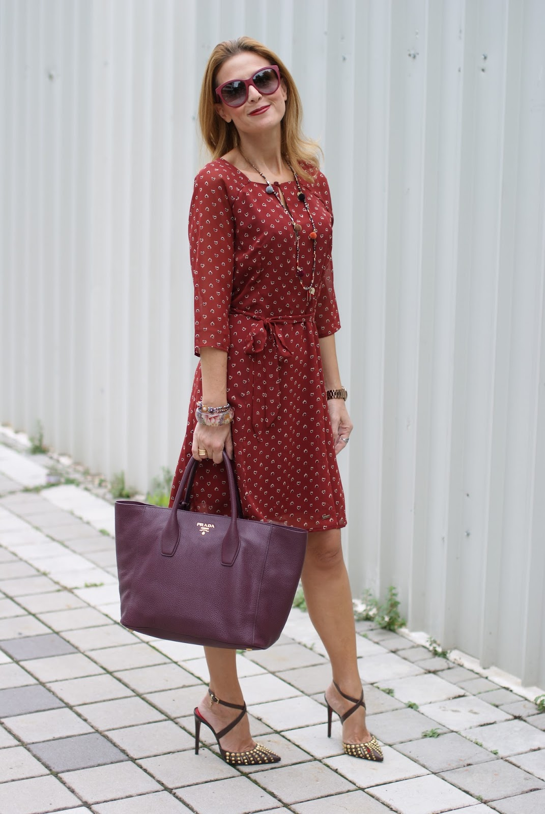 Mismash rust Zuchi dress, studded heels and burgundy Prada tote on Fashion and Cookies fashion blog, fashion blogger style
