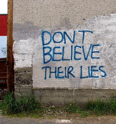 Spray paint graffiti which reads: Don't believe their lies