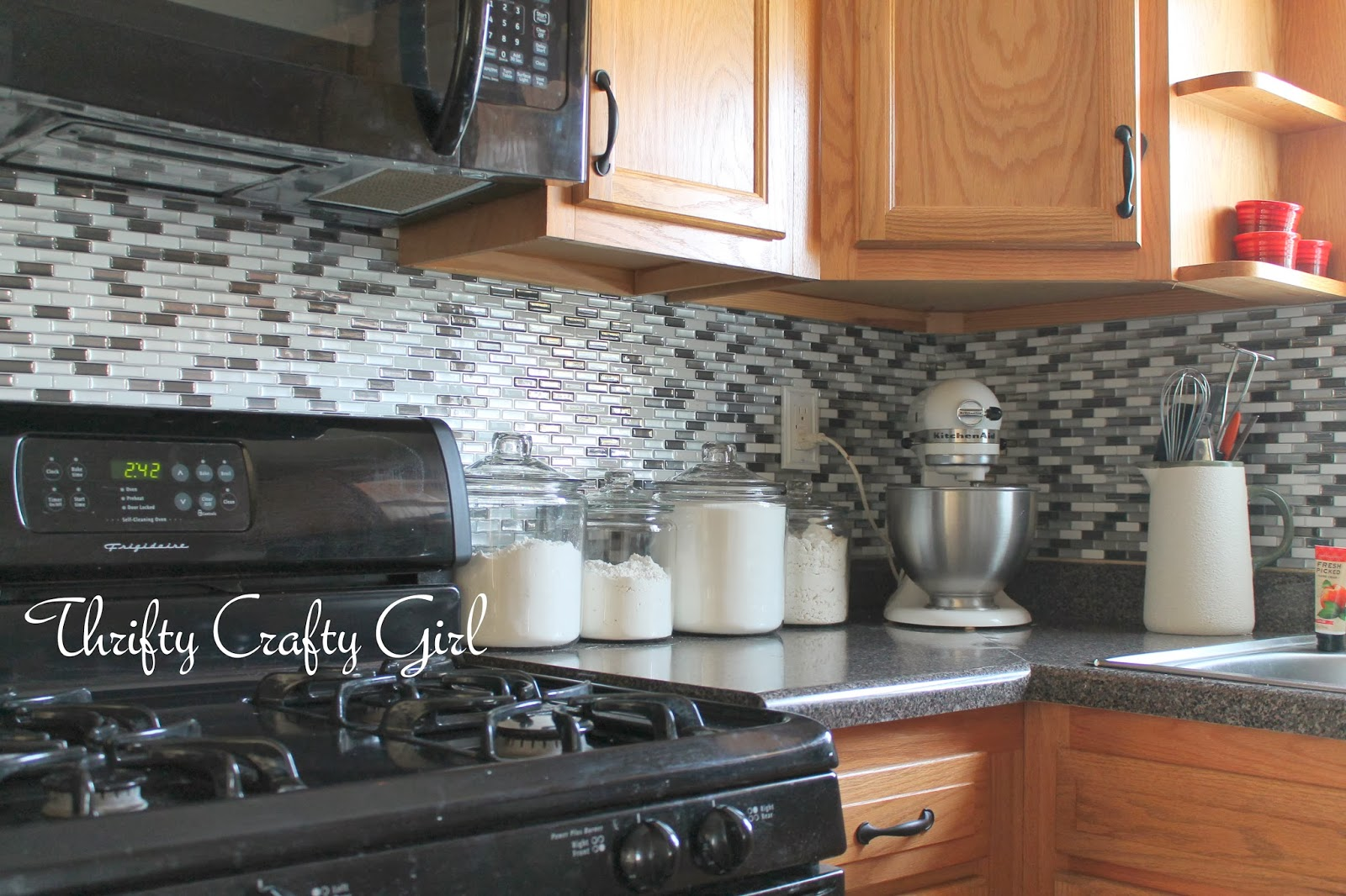 Thrifty crafty girl easy kitchen backsplash with smart tiles and another bonus these are removable take a hair dryer to the corner of a tile and heat it up it will peel off if you decide youre over dailygadgetfo Images