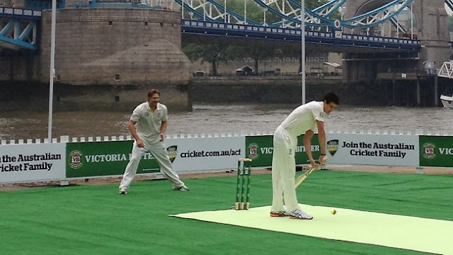 floating cricket pitch on river thames by tower bridge