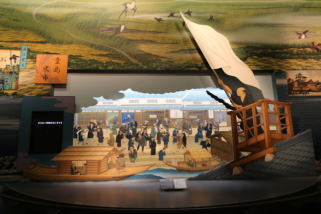 Trading business at the port during the early days at Museum of History in Osaka, Japan