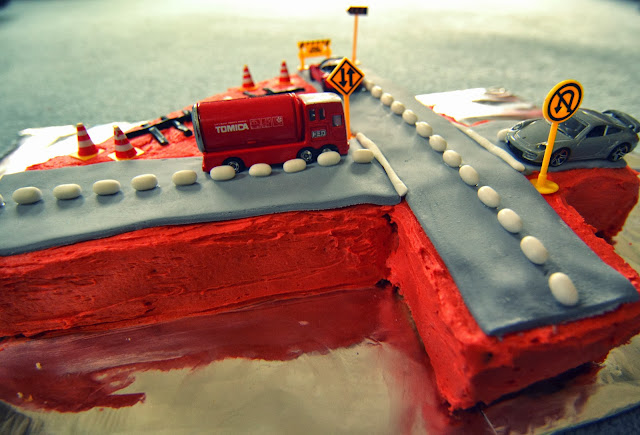 Number 4 shaped birthday cake with roads