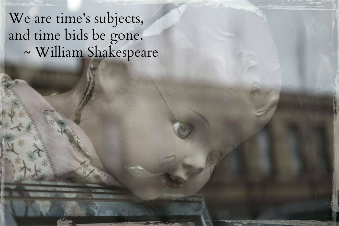 Cracked doll in window with Shakespeare quote