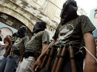 Masked members of al-Aqsa Martyrs Brigades