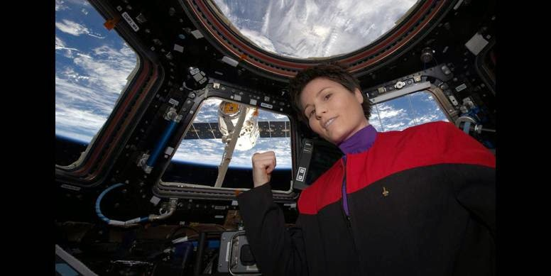 "Italian astronaut Samantha Cristoforetti, operating the space station's robot arm, captured a SpaceX Dragon cargo ship early Friday after a three-day rendezvous. Among the 2 tons of supplies and equipment on board: an espresso maker, supplied by Italy. In a post-capture tweet, Cristoforetti, a science fiction fan, channeled Captain Janeway of the ""Star Trek: Voyager"" TV series, saying ""there's coffee in that nebula."" (Credit: NASA TV)"