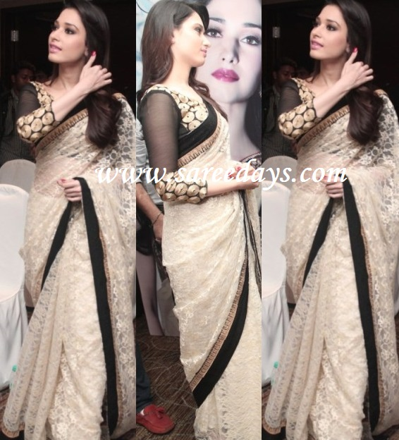 Latest saree designs tamanna in white designer saree checkout tamanna in white designer saree with black border and paired with matching full sleeves blouse altavistaventures Images