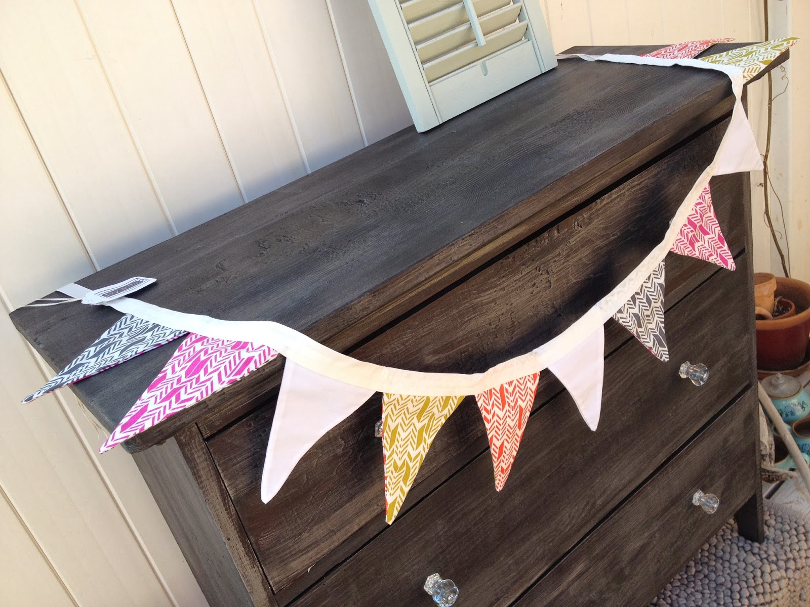 arrow bunting on refurbished antique dresser black